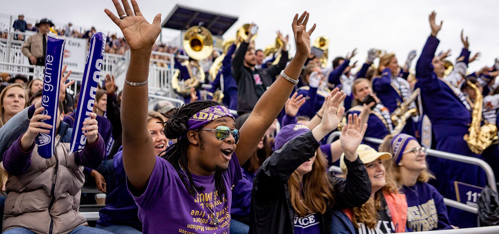 Crowd cheering at a JMU football game